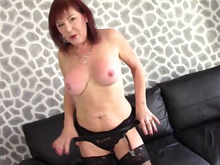 Wendy Taylor moans in pleasure during her solo masturbating set-to