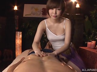 Uncivil haired Japanese Satomi Yuria massages a cock around her pussy