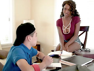 Curly-haired black MILF procurement fucked by a young white lad