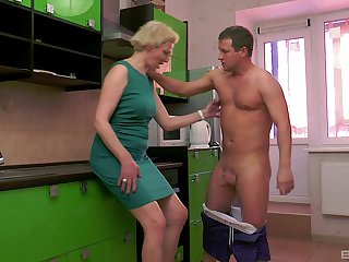 Grown-up short haired blonde wife Elena pussy pounded in the kitchen