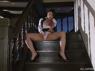 Japanese MILF brunette Saionji Reo masturbates on the stairs