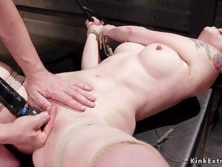 Petite slave clit fondled in bondage