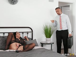Angela Uninspired in black lingerie and with a buttplug in her ass