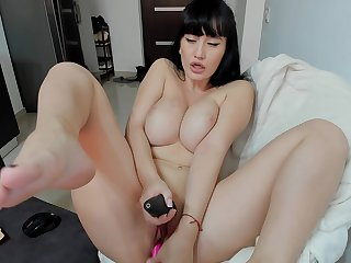 Lovely girl plays with her pussy in hot solo action
