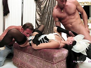 Hot to trot woman handles a handful of males in a serious trio