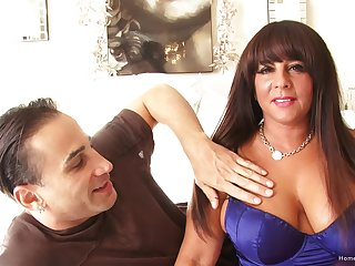 Impetuous brunette MILF with huge tits takes his dick deep