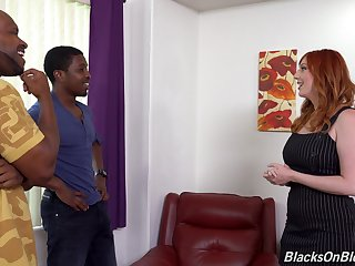 Red-haired MILF Lauren Phillips gets it from two black studs