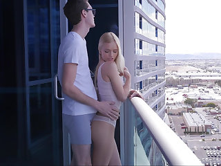 Seducing a blonde on a balcony